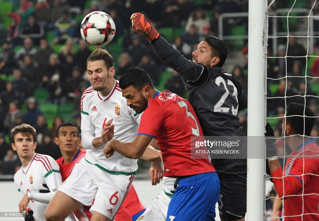 Costa Rica's Giancarlo González (C) and goalkeeper Leonel Moreira (R) vie for the ball with Hungary's Zsolt Korcsmar (L) during the international friendly football match Hungary v Costa Rica in Budapest, on November 14, 2017. /