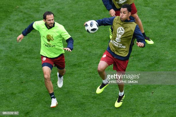 Costa Rica's goalkeeper Keylor Navas and Costa Rica's forward Marco Urena attend a training session at the Saint Petersburg stadium in Saint...