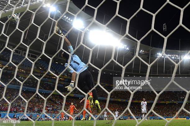 Costa Rica's goalkeeper Keylor Navas makes a save during extra time in the quarterfinal football match between Netherlands and Costa Rica at the...