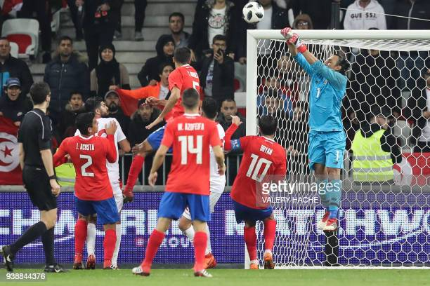 Costa Rica's goalkeeper Keylor Navas makes a save during the international friendly football match between Tunisia vs Costa Rica on March 27 2018 at...