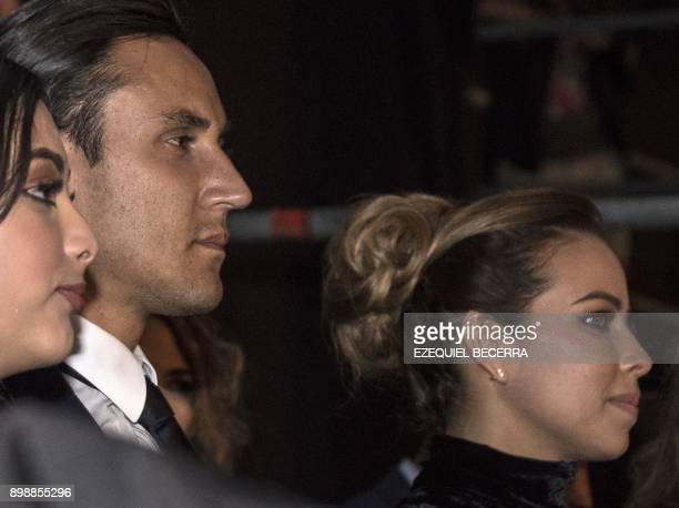 Costa Rica's goalkeeper Keylor Navas now playing for Real Madrid and his wife Andrea Salas arrive for the premiere of the movie on his life Man of...