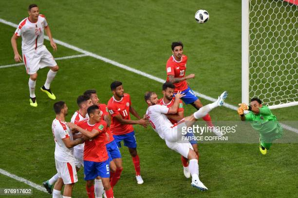 TOPSHOT Costa Rica's goalkeeper Keylor Navas punches the ball away from Serbia's defender Branislav Ivanovic during the Russia 2018 World Cup Group E...