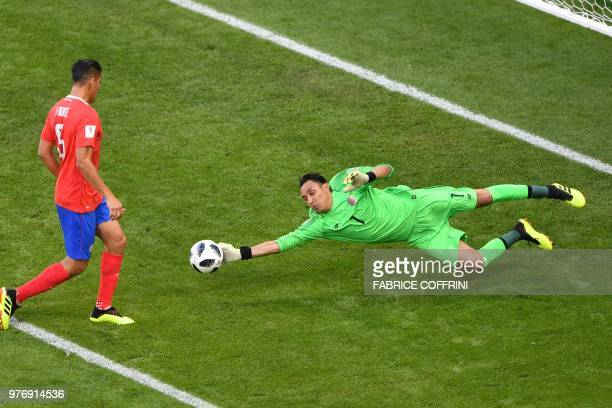 TOPSHOT Costa Rica's goalkeeper Keylor Navas reaches to save the ball during the Russia 2018 World Cup Group E football match between Costa Rica and...