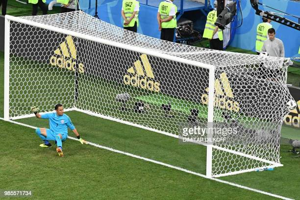 TOPSHOT Costa Rica's goalkeeper Keylor Navas reacts as he takes Switzerland's second goal during the Russia 2018 World Cup Group E football match...