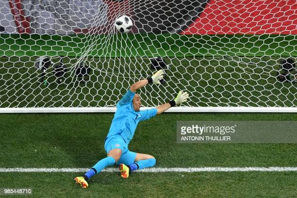 TOPSHOT Costa Rica's goalkeeper Keylor Navas takes the opening goal during the Russia 2018 World Cup Group E football match between Switzerland and...