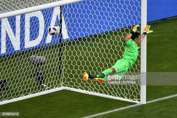 TOPSHOT Costa Rica's goalkeeper Keylor Navas tries to save a shot during the Russia 2018 World Cup Group E football match between Costa Rica and...