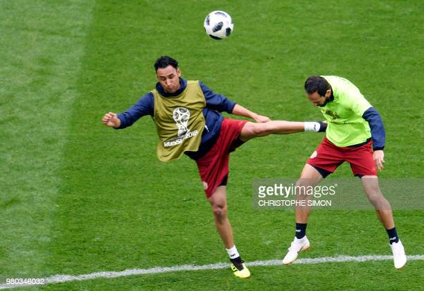 Costa Rica's goalkeeper Keylor Navas vies with Costa Rica's forward Marco Urena during a training session at the Saint Petersburg stadium in Saint...