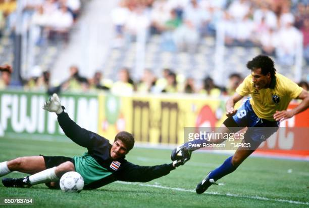 Costa Rica's Goalkeeper Luis Conejo pulls down Careca of Brazil during the striker's attempt to score