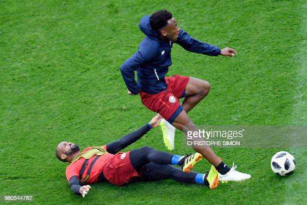 Costa Rica's goalkeeper Patrick Pemberton and Costa Rica's midfielder Rodney Wallace attend a training session at the Saint Petersburg stadium in...