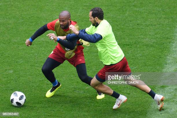 Costa Rica's goalkeeper Patrick Pemberton vies with Costa Rica's forward Marco Urena during a training session at the Saint Petersburg stadium in...