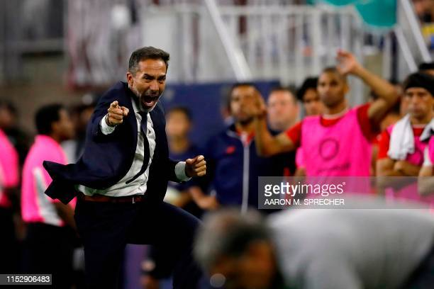 Costa Rica's head coach Gustavo Matosas reacts to a call on the field during the CONCACAF Gold Cup Quarterfinal football match between Mexico and...