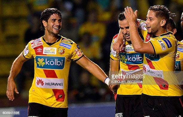 Costa Rica's Herediano Pablo Salazar Yendrick Ruiz and Elias Aguilar celebrate a goal again Panama's Plaza Amador during the CONCACAF Champions...