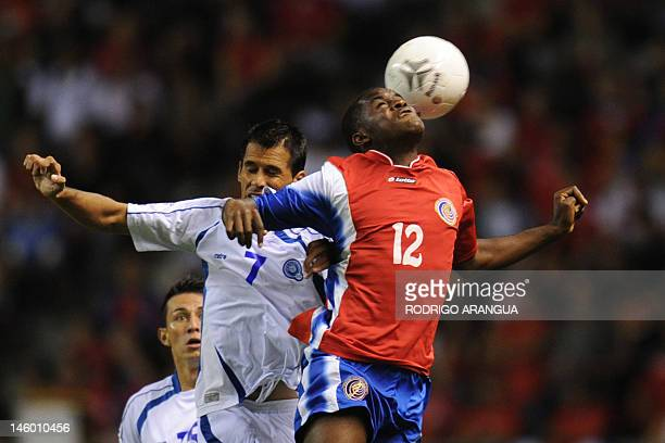 Costa Rica's Joel Campbell vies for the ball with El Salvador's Ramon Sanchez during their FIFA World Cup Brazil 2014 North Central America and...
