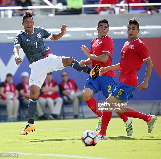 Costa Rica's Johnny Acostaand Oscar Duartevie for the ball with Paraguay's Jorge Benitezduring their match for the Copa America Centenario football...