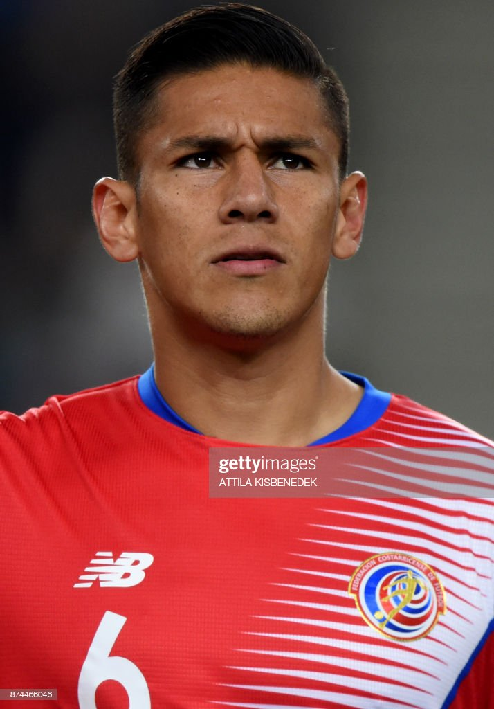 Costa Rica's José Salvatierra listens to their national anthem prior to a friendly football match against Hungary on November 14, 2017 in Groupama Arena of Budapest. /