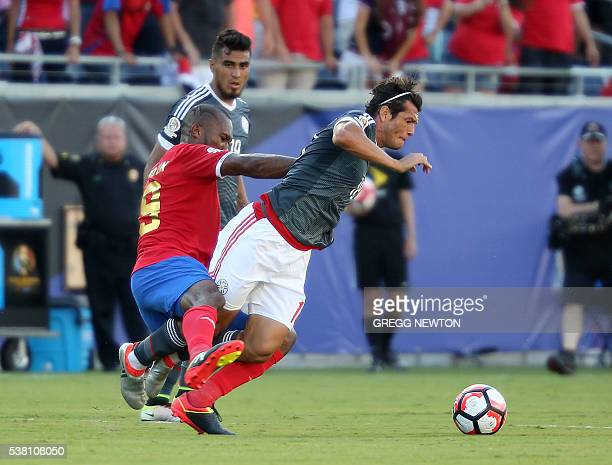 Costa Rica's kendall Watsonfouls Paraguay's Nelson Haedo Valdez during the Copa America Centenario football tournament in Orlando Florida United...