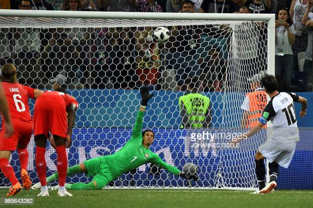 TOPSHOT Costa Rica's midfielder Bryan Ruiz shoots a penalty leading to the Swiss goalkeeper scoring an own goal during the Russia 2018 World Cup...
