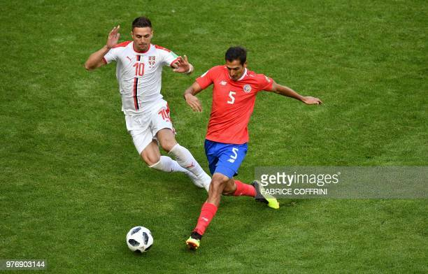 TOPSHOT Costa Rica's midfielder Celso Borges is marked by Serbia's forward Dusan Tadic during the Russia 2018 World Cup Group E football match...