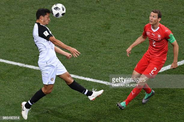 TOPSHOT Costa Rica's midfielder Celso Borges vies for the ball with Switzerland's defender Stephan Lichtsteiner during the Russia 2018 World Cup...