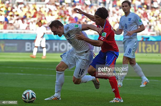 Costa Rica's midfielder Cristian Bolanos challenges England's defender Phil Jones during a Group D match between Costa Rica and England at the...
