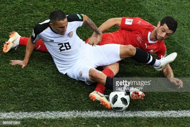 TOPSHOT Costa Rica's midfielder David Guzman vies for the ball with Switzerland's midfielder Blerim Dzemaili during the Russia 2018 World Cup Group E...