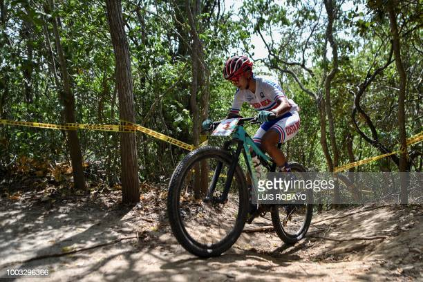 Costa Rica's Milagro Mena competes in the Women's Mountain Bike Cross Country finals event of the cyclying competition of the 2018 Central American...