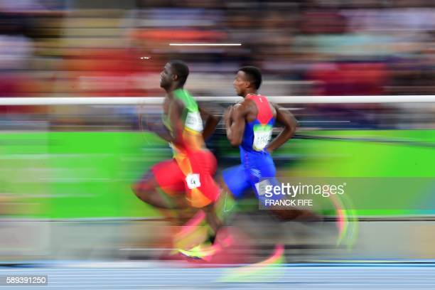 TOPSHOT Costa Rica's Nery Brenes and Grenada's Kirani James compete in the Men's 400m Semifinal during the athletics event at the Rio 2016 Olympic...