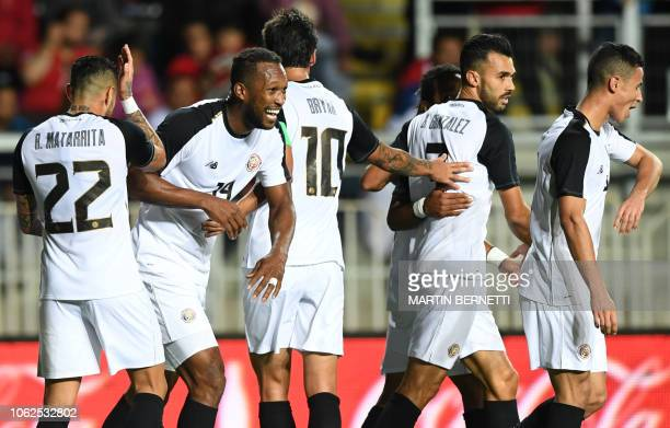 Costa Rica's player Kendall Waston , celebrates with teammates after scoring against Chile, during a friendly football match at El Teniente stadium,...