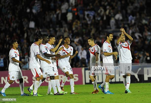 Costa Rica's players celebrate their win over Uruguay at the end of their friendly football match at Centenario Stadium in Montevideo on November 13...