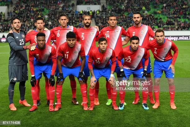 Costa Rica's players Giancarlo Gonzalez Johan Venegas Cristian Gamboa Ronald Matarrita and Kenner Gutierrez goalkeeper Leonel Moreira Daniel...