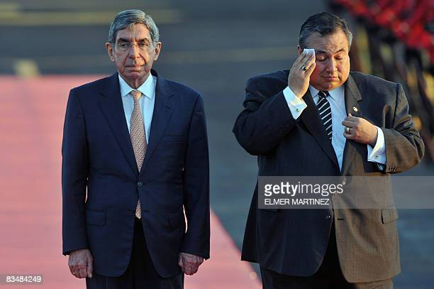 Costa Rica's President Oscar Arias and El Salvador's Vice Foreign Minister Luis Montes review an honor guard upon arrival to El Salvador's airport in...