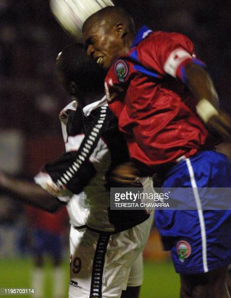 Costa Rica's Reynaldo Parks and Trinidad y Tobago's Dwight Yorke both attempt to head the ball 28 March 2001 during their CONCACAF World Cup 2002...