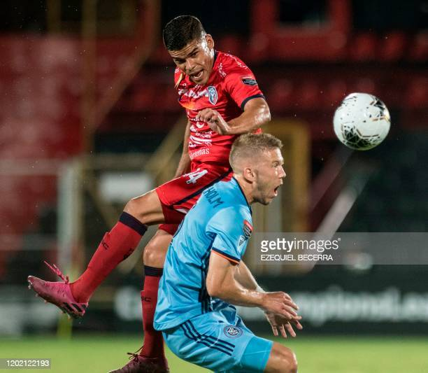 Costa Rica's San Carlos player Jose Sanchez vies for the ball with USA's New York City FC player Anton Tinnerholm during their CONCACAF Champions...