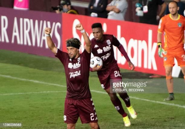 Costa Rica's Saprissa Christian Bolanos celebrates next to Orlando Sinclair after scoring against Guatemala's Comunicaciones during their Concacaf...