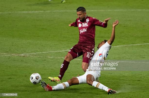 Costa Rica's Saprissa Marvin Angulo vies for the ball with Guatemala's Comunicaciones Jose Contreras during their Concacaf Champions league...