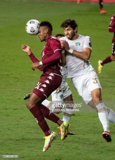 Costa Rica's Saprissa Orlando Sinclair vies for the ball with Guatemala's Comunicaciones Nicolas Samayoa during their Concacaf Champions league...