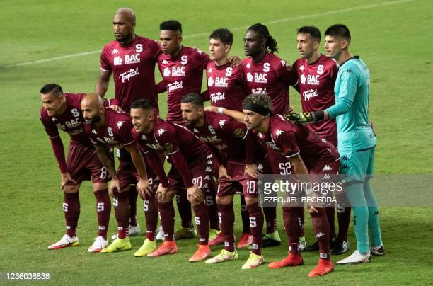 Costa Rica's Saprissa players pose for a picture before their Concacaf Champions league quarter-final first leg football match against Guatemala's...