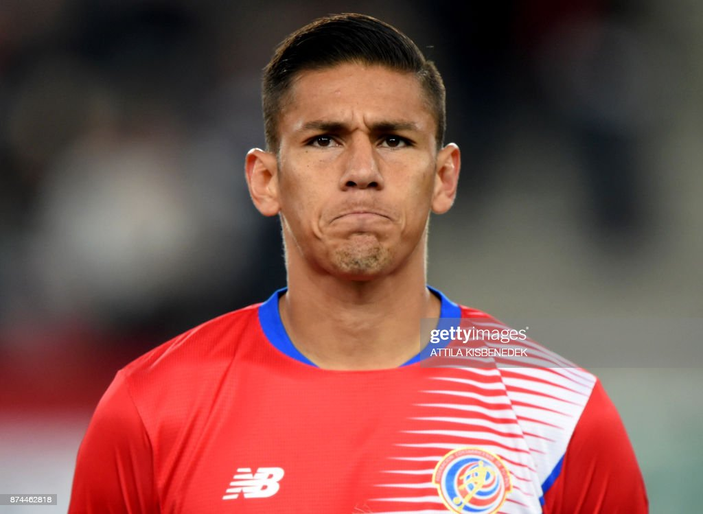 Costa Rica's Óscar Duarte listens to the national anthem prior to a friendly football match against Hungary on November 14, 2017 in Groupama Arena of Budapest. /