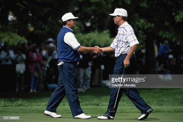 Costantino Rocca of Europe shakes hands with Davis Love III of the United States after losing his singles match 3 and 2 during the 31st Ryder Cup...