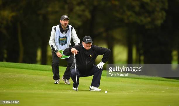 Costantino Rocca of Italy lines up his putt on the 1st green during Day One of the Farmfoods European Senior Masters at Forest Of Arden Marriott...