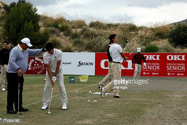 Costantino Rocca of Italy teaches some of the Murcia Junior team on the practice area after the first round of the OKI Open de Espana Senior by...