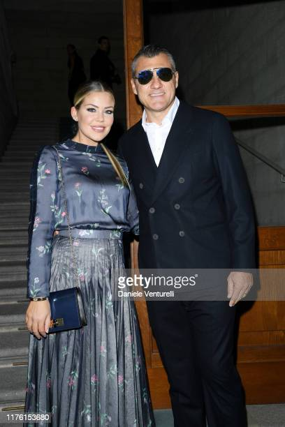 Costanza Caracciolo and Christian Vieri attend the Giorgio Armani fashion show during the Milan Fashion Week Spring/Summer 2020 on September 21, 2019...