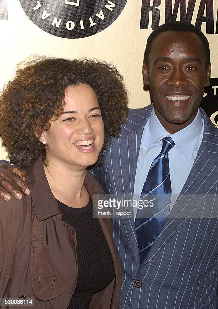 Costar Don Cheadle and his wife arrive at the premiere of Hotel Rwanda