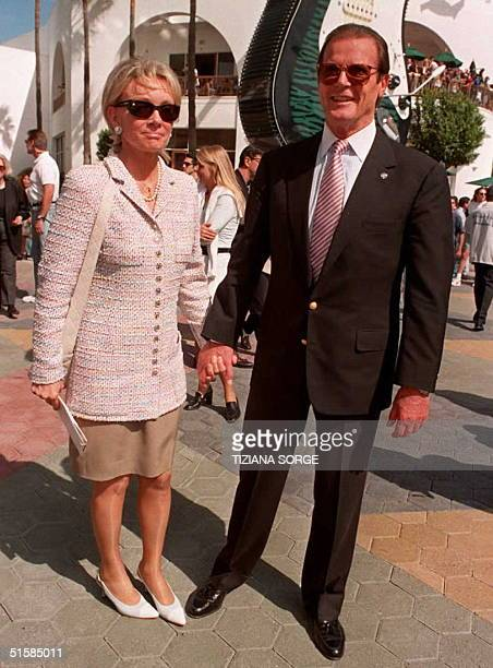 """Co-star of the movie """"The Quest,"""" Roger Moore arrives at the movie's premier with his girlfriend Kristina Throlstrup 20 April in Studio City, CA. The..."""