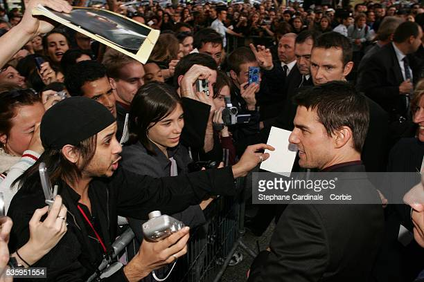 Costar Tom Cruise greets hundreds of fans outside the cinema venue on his arrival at the premiere of 'Collateral' in Paris