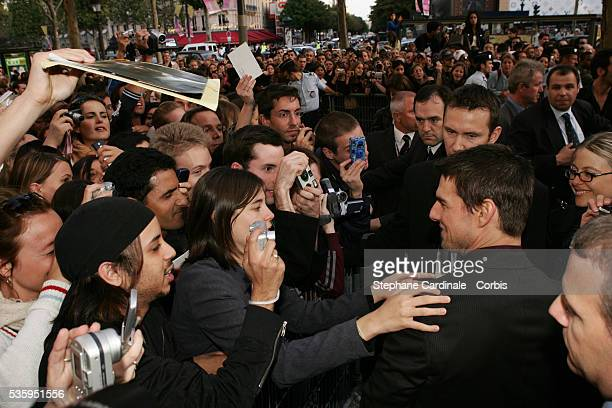 Costar Tom Cruise greets hundreds of fans outside the premiere venue on his arrival at the premiere of 'Collateral' in Paris