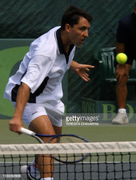 Costarican tennis player Juan Antonio Marin tries to hit the ball 09 February 2001 during a Davis Cup American Zone selection match in Escazu Costa...
