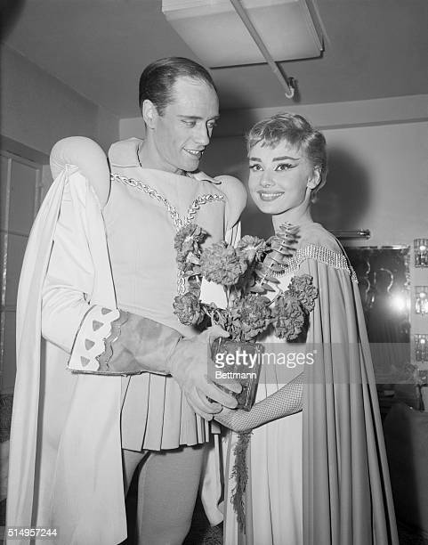 Costars Audrey Hepburn and Mel Ferrer hold flowers backstage at the opening of the play Ondine February 18th at the 46th Street Theater Presented by...