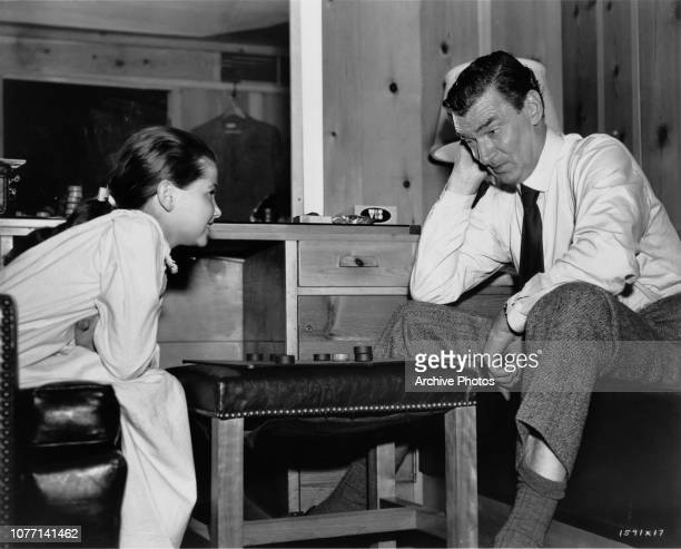 Costars Donna Corcoran and Walter Pidgeon playing checkers on the set of the MGM film 'Vicky' later titled 'Scandal at Scourie' 1952