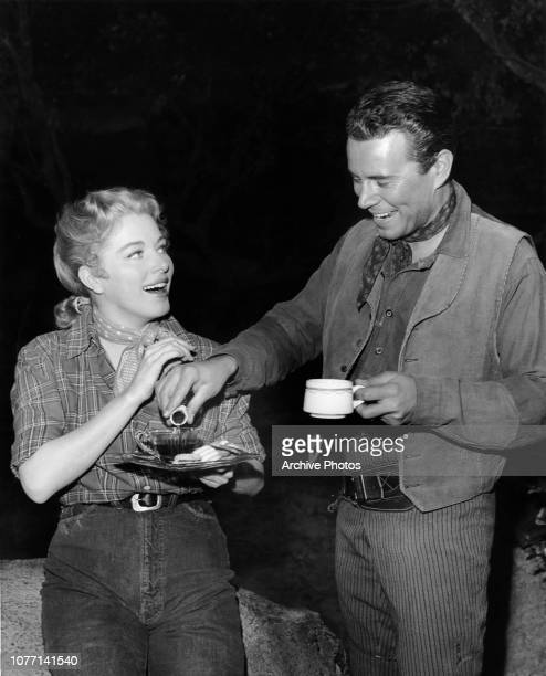 Costars Eleanor Parker and John Forsythe share a coffee on the set of the MGM film 'Escape From Fort Bravo' 1953